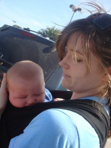 Kendall at 10 weeks old, snuggled in my Moby Wrap in the Texas summer heat because it's all that soothed him.