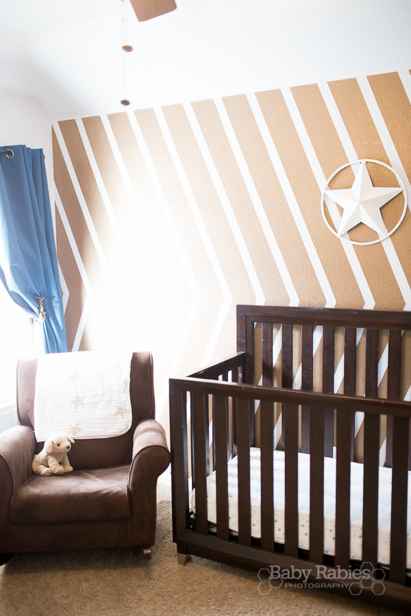 Blue and gold, dog themed nursery with gold arrow wall | BabyRabies.com - Gold arrow wall