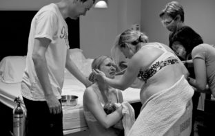 Beautiful surrogate birth photo by Genevieve Georget