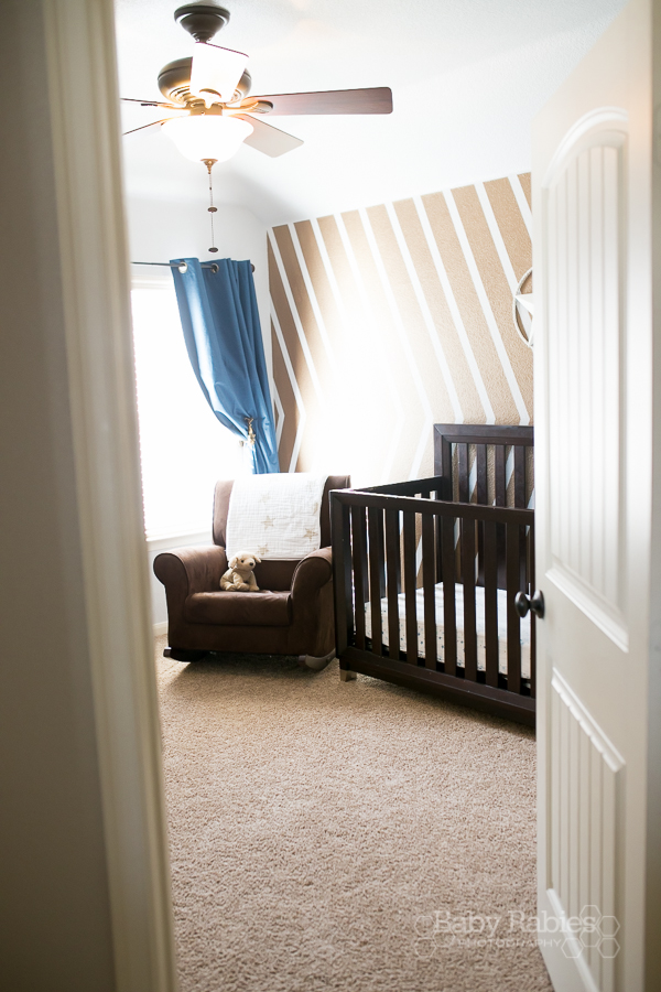 Blue and gold, dog themed nursery with gold arrow wall | BabyRabies.com