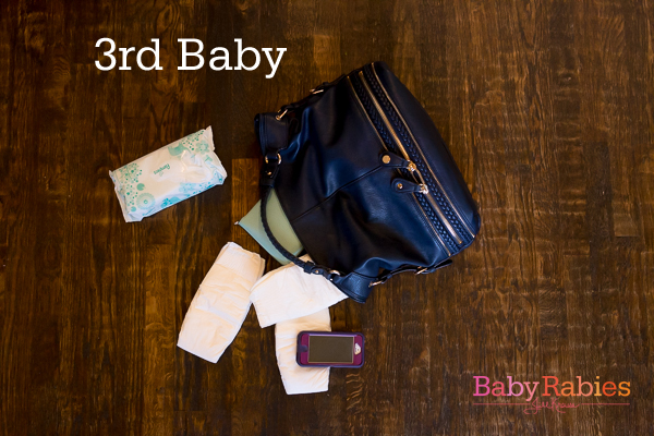 What my diaper bag contents looked like for my 1st, 2nd, and 3rd baby. | BabyRabies.com