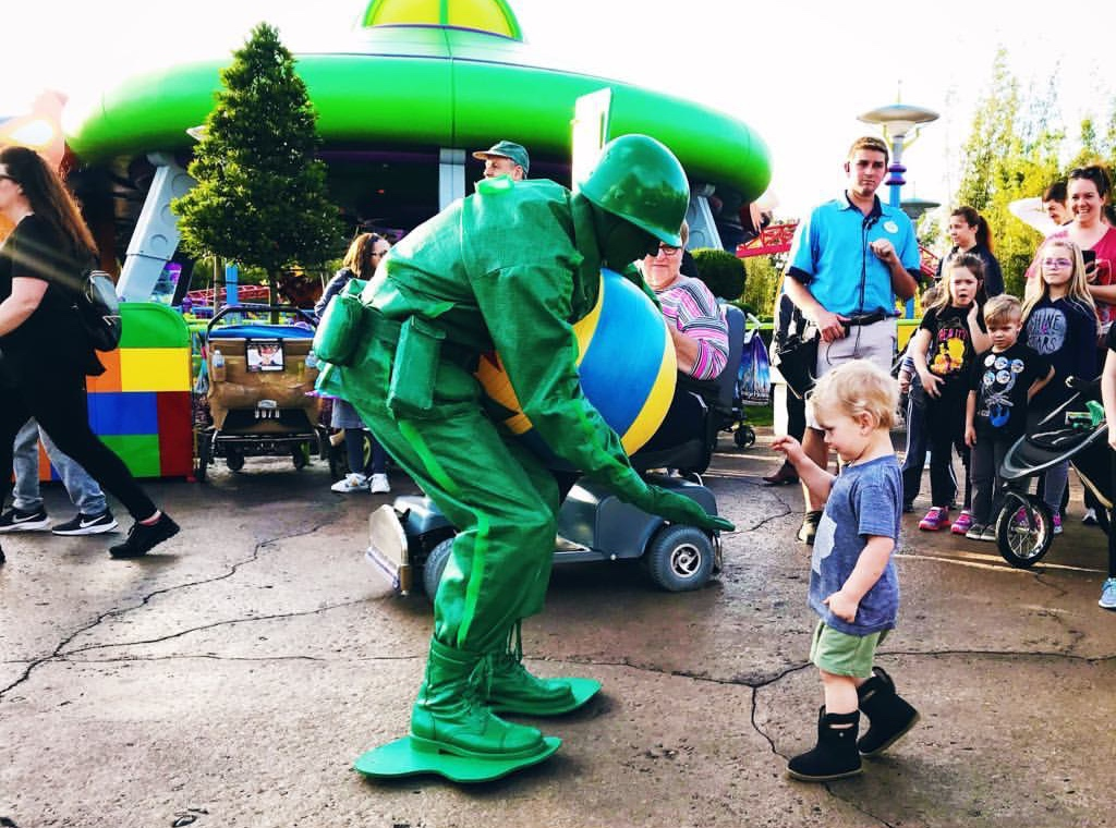 image of toddler giving high five with Toy Story soldier