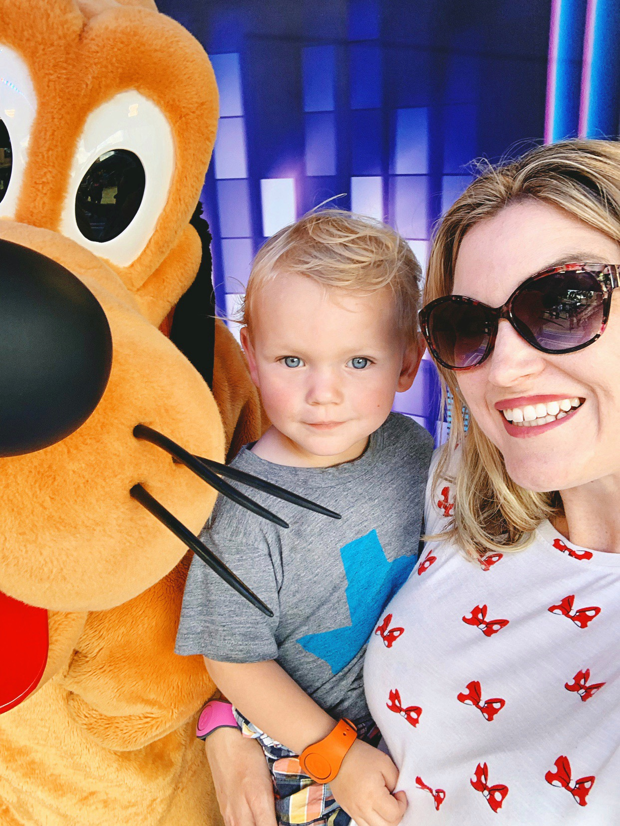 image of toddler posing with Pluto character